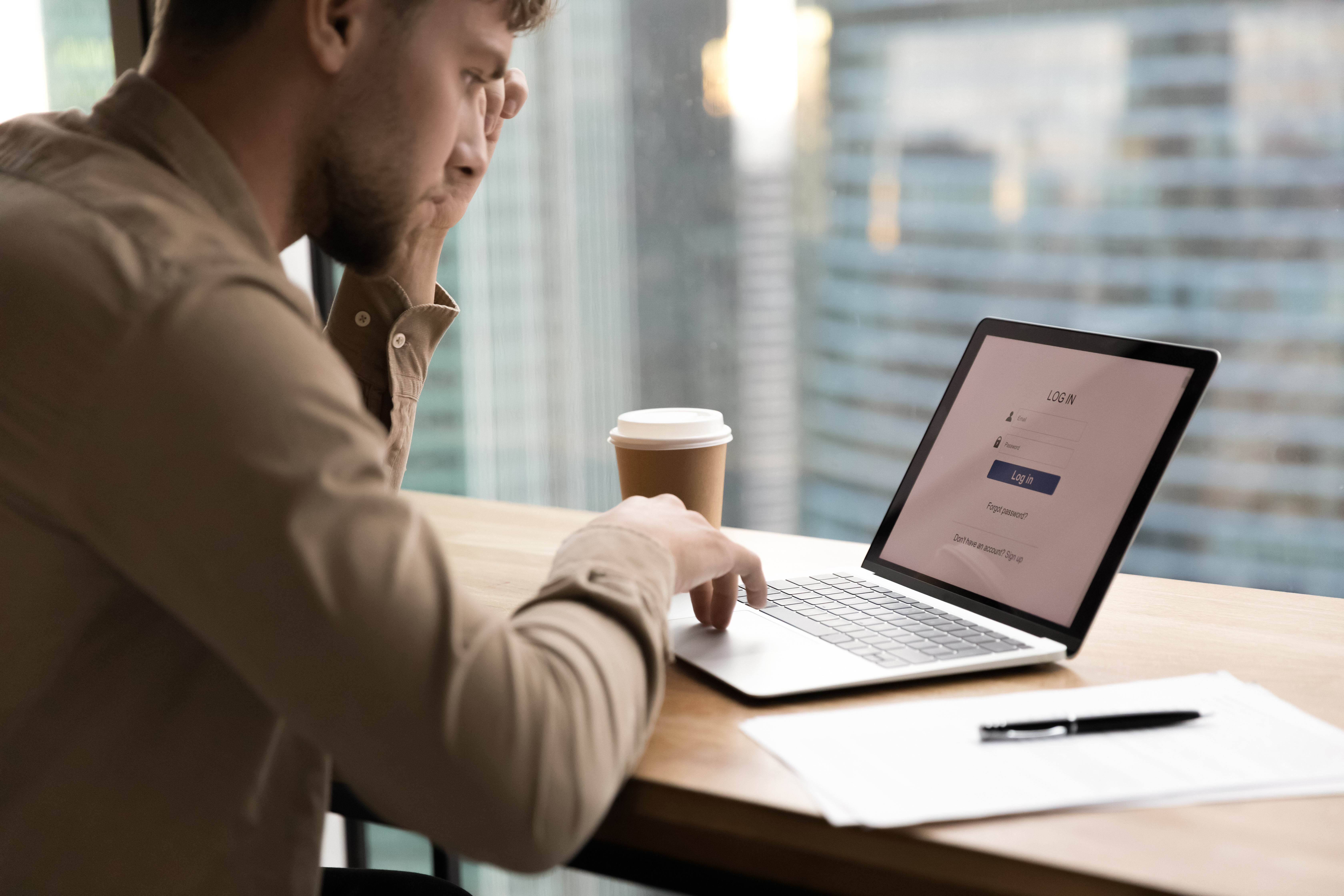 man looking at the login page for SSO
